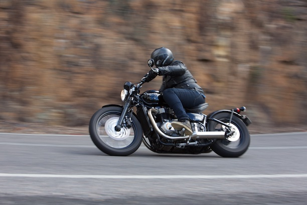 Triumph Bonneville Bobber 2017 left side action shot