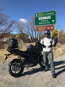 versys 650 with wilburs rear shock parked in front of road sign