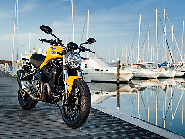 Ducati Monster 821 2018 model yellow right side static three quarter