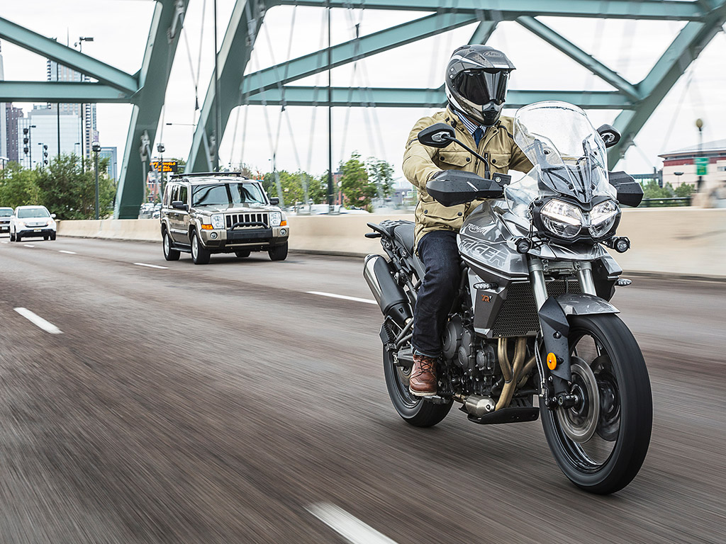 2018 Triumph tiger 800 unveiled XRT action tracking front three quarter crossing bridge